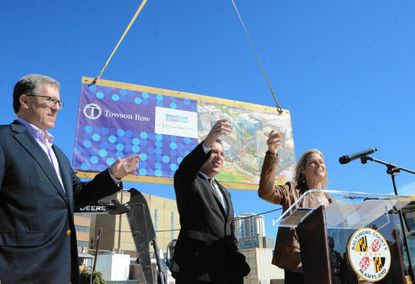 Towson Chamber of Commerce Director Nancy Hafford, right, offers a toast to celebrate construction at the Towson Row mixed-use development on Friday morning. She's joined by County Executive Kevin Kamenetz, center, and Arthur Adler of Caves Valley Partners, left. Towson Row will include offices, apartments, student housing, retail shops and restaurants. Business and government officials praised the project Friday as a continuation of redevelopment in Towson.