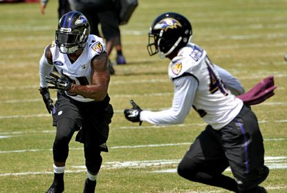 Ravens safety Terrence Brooks, left, returned to practice this month after suffering a torn ACL and MCL last December. He played in his first game since the injury Saturday against the Washington Redskins.
