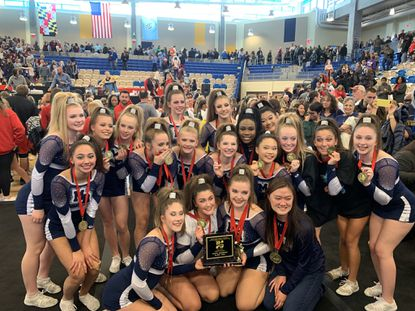 The Marriotts Ridge cheerleading team poses for a photo after winning the Class 1A/2A state championship on Saturday, Nov. 9, 2019, at Harford Community College.