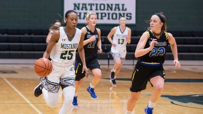 Stevenson senior guard Jonyae Curry, a Westminster High graduate, dribbles the ball in a game against Widener at Owings Mills.