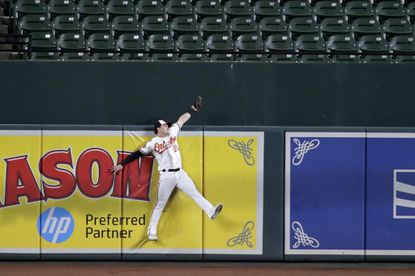 Orioles center fielder Austin Hays makes the catch at the wall on a ball hit by Toronto Blue Jays' Vladimir Guerrero Jr. during the fourth inning Thursday.