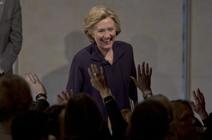 Democratic presidential candidate Hillary Clinton greets members of the audience during a Glassdoor Pay Equality Roundtable, Tuesday in New York.