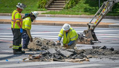 In July, workers dig at the intersection of Bosley Road and Joppa Road in Towson where a water main break and natural gas leak were remediated.