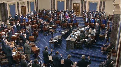 In this image from video, Sen. Patrick Leahy, D-Vt., the president pro tempore of the Senate, who is presiding over the impeachment trial of former President Donald Trump, swears in members of the Senate for the impeachment trial at the U.S. Capitol in Washington, Tuesday, Jan. 26, 2021. (Senate Television via AP)