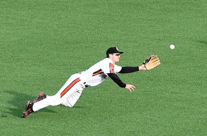 Aberdeen outfielder Adam Hall attempts to make the diving grab on a Rome fly ball during Tuesday's game at Leidos Field at Ripken Stadium.