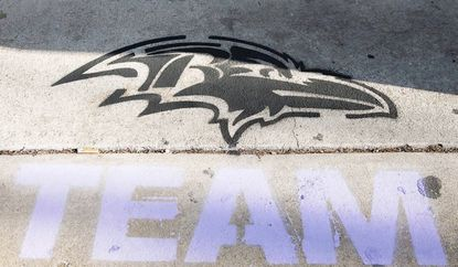 The Ravens' logo was stenciled on the sidewalk in front of Cal Bloom's Barber Shoppe on Main Street in Westminster this year, as it was last year for the team's playoff run.
