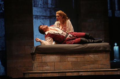 "The tomb scene from Lyric Opera Baltimore's production of ""Romeo et Juliette"" with Jonathan Boyd (Romeo) and Sarah Joy Miller (Juliette)."