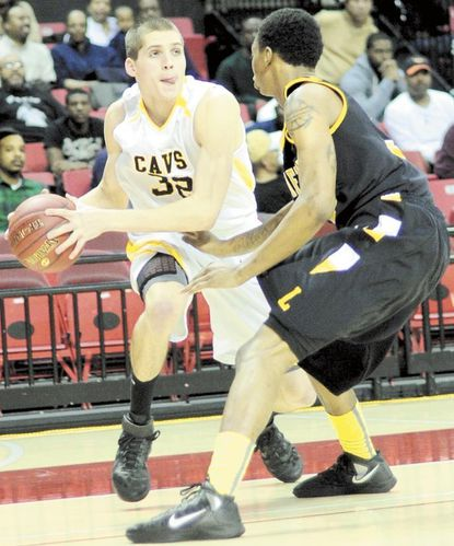 SC's Gavin McTavish looks to pass in front of Lake Clifton's Rodney Hawkins on Friday.