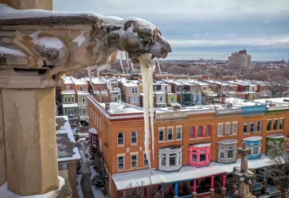 Icicles hang from the mouth of a gargoyle atop St. John's of Baltimore City United Methodist Church in Charles Village as snow begins to melt after the recent winter storm. (Jerry Jackson/Baltimore Sun).