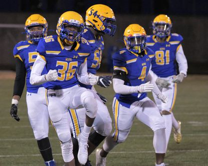 Mervo teammates follow Laquwen Jefferson (36), who reacts after intercepting a pass against Westminster to seal a victory during the MPSSAA Class 3A quarterfinals Fri., Nov. 22, 2019.
