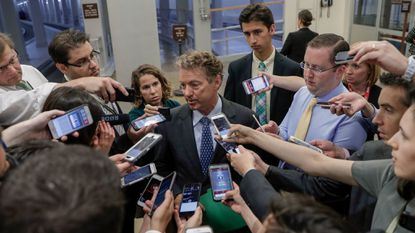 Sen. Rand Paul, a Kentucky Republican, speaks to reporters at the Capitol after Republicans released their long-awaited bill to scuttle much of President Barack Obama's Affordable Care Act, at the Capitol in Washington, Thursday, June 22, 2017.