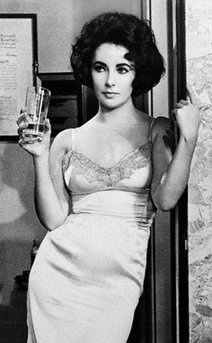 "Elizabeth Taylor made a statement in a slip dress in 1961's ""Butterfield 8."" The costume designer for the film was Helen Rose."