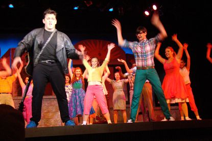 """Isaac Simonaire (as Chad), left, and Billy Luzier (as Dennis) perform during the Talent Machine Company''s production of """"""""All Shook Up."""""""""""