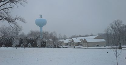 Winter wasn't giving up easily in Harford, as snow falls around the Vale Road water tank near Bel Air at 9:45 a.m. Friday. Spring is due to officially arrive at 6:45 p.m.