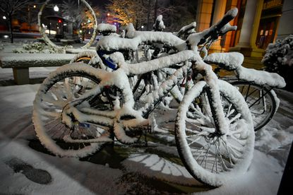 Wet snow clings to bicycles near Johns Hopkins campus following an overnight snowstorm.