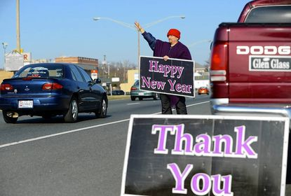 As seasonal temperatures finally move into the area, avid outdoorsman and Maryland District 34A Del. Glen Glass, offers holiday greetings to drivers along Route 40 in Aberdeen Saturday. Glass and the Maryland General Assembly convene for the 2013 legislative session today (Wednesday).