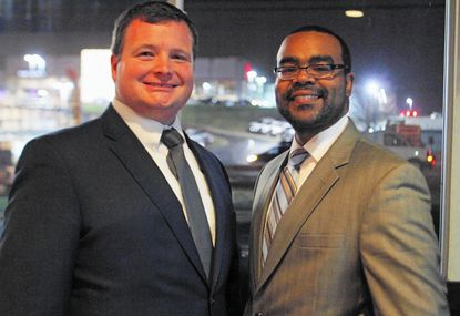 District 44B state Del. Pat Young, left, and newly appointed Sen. Charles Sydnor, a former delegate, pose at a store on Baltimore National Pike in Catonsville.
