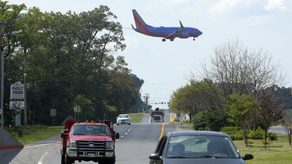 A plane flies over Dorsey Road in Glen Burnie in this 2016 file photo as it prepares to land at BWI Marshall airport.