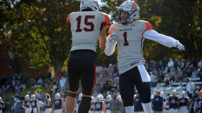 McDonogh Eagles' Dane Swanson (1) celebrates a touchdown by Preston Howard (15) against the Gilman Greyhounds during the rivalry Gilman-McDonogh football game at Alexander Sotir Stadium.