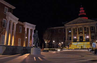 View of the State House's lit steps from Lawyers Mall as Maryland commemorated the one-year anniversary of the state's first confirmed case of COVID-19 at a ceremony outside the Maryland State House on Friday, March 5, 2021.