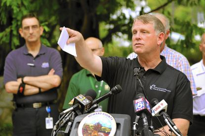 Howard County Executive Allan Kittleman, at podium, and other Howard County officials held a press conference to provide updates on the recovery and cleanup underway in Ellicott City on July 31. Kittleman has asked the County Council to extend the state of emergency in Ellicott City as crews continue cleanup and secure the city ravaged by flash floods on Saturday, July 30.