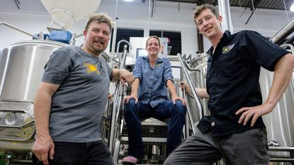 Checkerspot Brewing Co. owners Steve Marsh, from left, Judy Neff and Rob Neff pose inside their South Baltimore brewery, which will open to the public in late June.