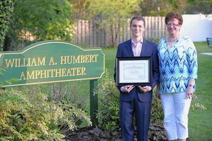 Ryan Parks, , left, the 2014 Humbert Scholarship recipient, stands with Tamara W. Zavislan, executive director of the Community Foundation of Harford County.