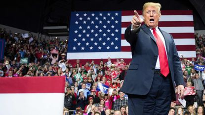 President Trump speaks at a rally in Fort Wayne, Ind., the night before the midterm election.