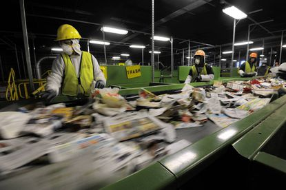 Inmates from the Baltimore County detention center sort recyclables at the county's new $23 million Material Recovery Facility (MRF) and transfer station. The single-stream recycling facility will process 35 tons of recyclables an hour according to a county press release and is expected to net between $750,000 and $2 million per year.