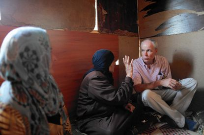 Kevin Hartigan, CRS Regional Director for Europe, the Middle East and Central Asia, talks with Syrian refugees in an informal tent settlement in Lebanon in 2012. Since the beginning of the Syrian war, CRS has assisted more than one million war-affected Syrians across the Middle East and Europe since the crisis began in 2011.