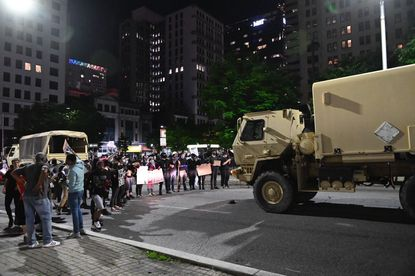 The presence of large National Guard vehicles in Baltimore during Monday's protests may have caused some confusion. No guard troops have been deployed to Baltimore in response to protests, but those already in town to help the city deal with the coronavirus outbreak provided transportation and logistical support.