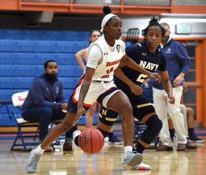 Morgan State's Sydney Searcy dribbles the ball during a game against Navy on Dec. 18, 2020.
