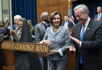 Speaker of the House Nancy Pelosi, a Baltimore-born Democrat from California, joined at right by Rep. Mark Meadows, a Republican from North Carolina, and others applaud at a ceremony to honor the late chairman of the House Oversight Committee, Rep. Elijah Cummings, a Maryland Democrat, by naming the committee room in the House Rayburn Office Building for the Baltimore native on Capitol Hill in Washington on Thursday.