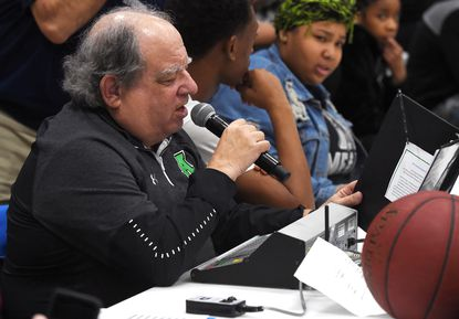 """Longtime Arundel High School scoreboard operator and announcer Jeff Amdur called his final game at the school on March 5. """"I think after 43 years, it's probably time to cut back a little,"""" Amdur said, """"and take it a little easier."""""""