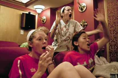 Maddie Boccio, in white, and from left, Danielle Nauman and Isabelle Kim, of the SAC U-15 United Premiere team, react to an intense moment of play in the FIFA Women's World Cup final between the United States and Japan, which Japan won in a penalty shootout.