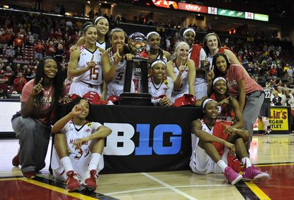 The Maryland Women's basketball team pose with the Big 10 trophy after defeating Minnesota 110-77 in an NCAA college basketball game, Sunday, Feb. 28, 2016, in College Park, Md.
