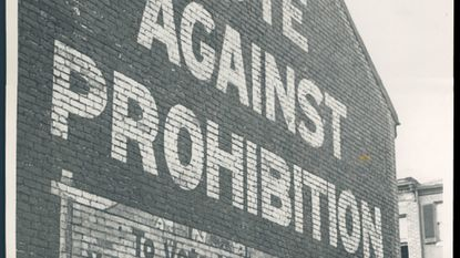 """A Baltimore wall mural says, """"Vote Against Prohibition. To Vote WET, You must vote AGAINST Prohibition."""""""
