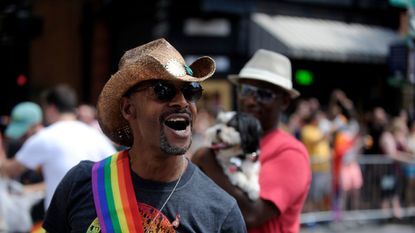 Derrick Booze of Baltimore marches with AIDS Action Baltimore in the Pride Parade in 2016.