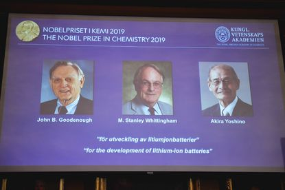 "A screen displays the laureates of the 2019 Nobel Prize in Chemistry, from left, John B. Goodenough, M. Stanley Whittingham, and Akira Yoshino ""for the development of lithium-ion batteries,"" during a news conference at the Royal Swedish Academy of Sciences in Stockholm, Sweden, on Oct. 9, 2019."