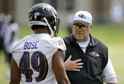 Ravens linebackers coach Don Martindale, right, speaks with linebacker Andrew Bose during training camp, Friday, Aug. 7, 2015, in Owings Mills.