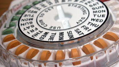 Birth control pills in their calendar dispensing packaging.