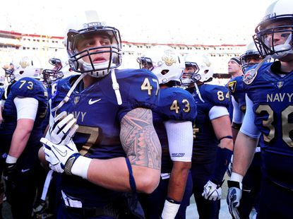 Navy's Maika Polamalu, shown before a 2011 game against Army at FedEx Field, is part of a lineage of talented football players.
