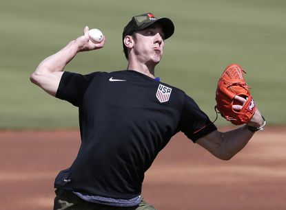 Free agent Tim Lincecum pitches for scouts Friday in Arizona.