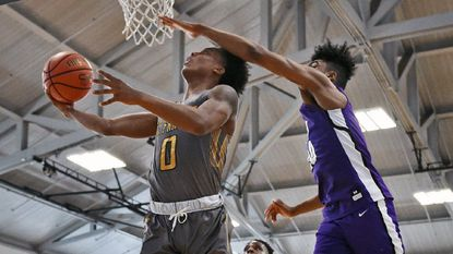 St. Frances' Rajeir Jones, left, drives past Mount Saint Joseph's James Bishop for a shot in the first quarter in the 2018 Baltimore Catholic League boys basketball final at Goucher College.