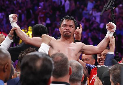 Manny Pacquiao celebrates after defeating Keith Thurman by split decision for the WBA welterweight title in Las Vegas on Saturday. Pacquiao's incredible victory is another chapter in his storybook career.