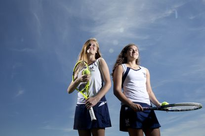 Marriotts Ridge senior Abby Thornton, left, and sophomore Veronica Cuellar are this year's Howard County Times girls tennis Co-Players of the Year after the duo won a county, region and state title in girls doubles.