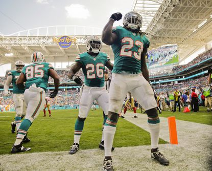 Dolphins running back Jay Ajayi (23) celebrates after scoring in the second quarter against the 49ers on Nov. 27, 2016 at Hard Rock Stadium in Miami Gardens, Fla.