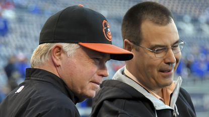 Orioles manager Buck Showalter, left, and executive vice president of baseball operations Dan Duquette.