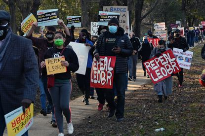 Demonstrators make their way from Annapolis District Court to Lawyer's Mall in a Maryland Coalition for Justice & Police Reform march to demand police reform. March 4, 2021. (Kim Hairston/Baltimore Sun).