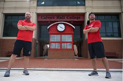 Calvert Hall football head coach Josh Ward, left, and his brother, assistant coach Mike Ward, at the school on Thursday, Sept. 10.
